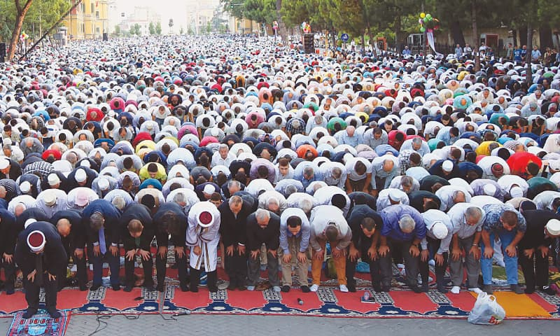 TIRANA: Albanians offer Eid prayers at the Martyrs of the Nation Boulevard here on Friday.—AP