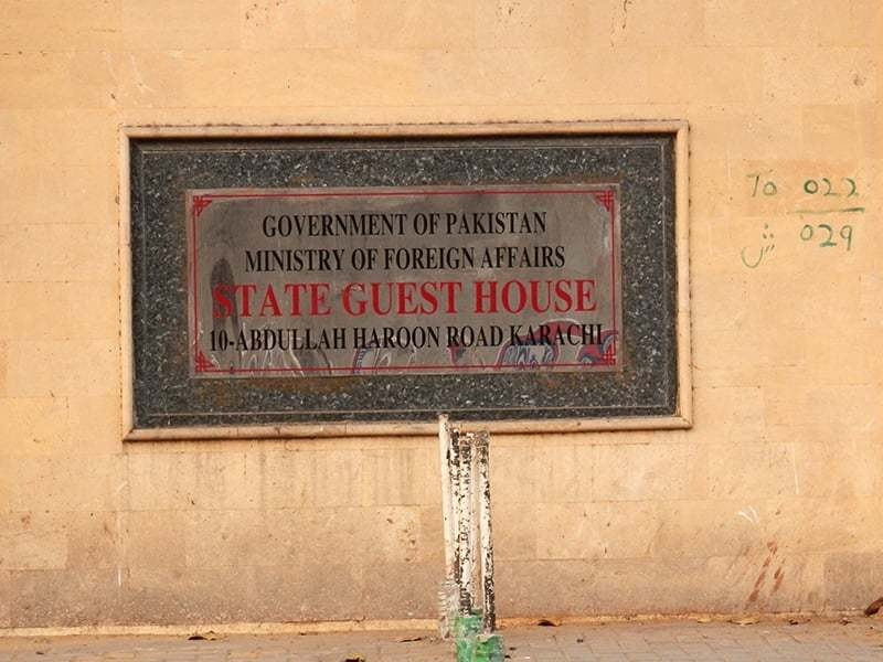 "A plaque, near the gate of number 10 Victoria Road, Karachi, reads ""State Guest House"". The address has also been updated to ""10-Abdullah Haroon Road, Karachi"". —Photo by Akhtar Balouch"