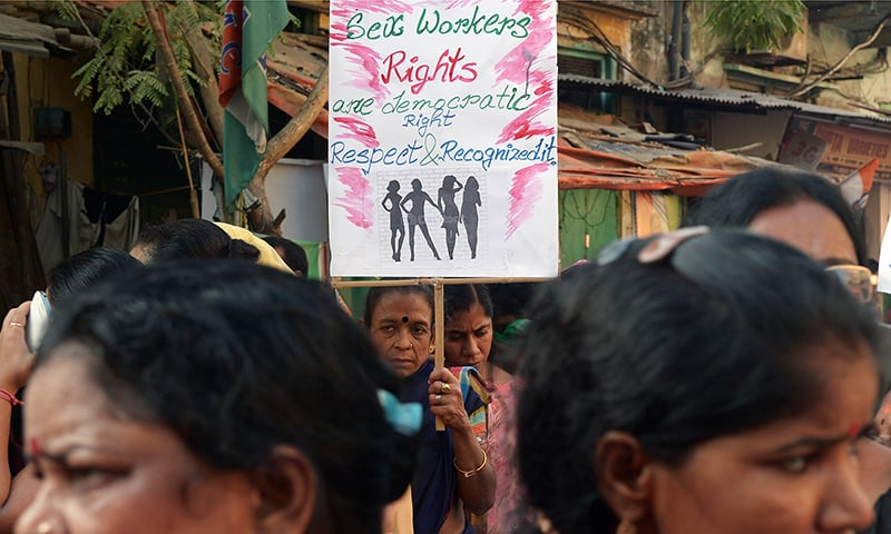 Indian sex workers hold placards as they participate in a rally. ─ AFP/File