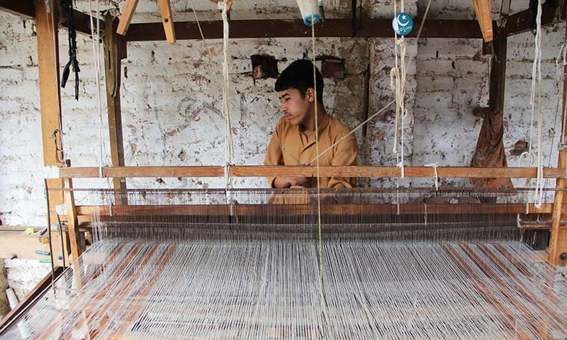 An artisan is weaving woolen shawl on his handloom. — Photo by author