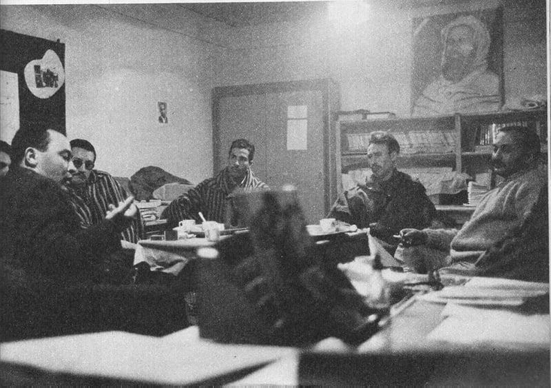 Houari Boumedienne (centre) with the think-tank of the FLN in 1962.  He ruled Algeria and headed the FLN from 1965 till 1978, putting Algeria 'on the socialist path.'