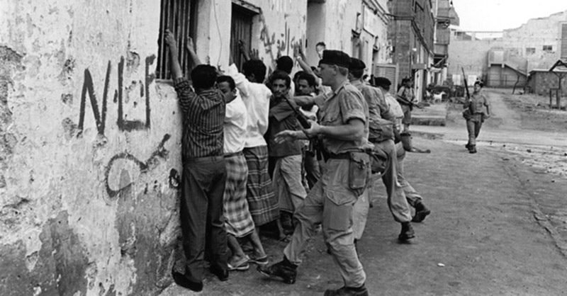 British soldiers pin National Liberation Front (NLF) sympathisers to the wall in Aden, Yemen, 1967.