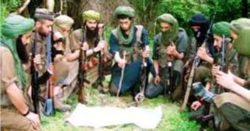 Algeria's Islamist guerrilla fighters holding a meeting in 1996. Groups of militant Islamists went to war with the Algerian military between 1992 and 2002. Thousands of Algerians were killed in the conflict until the Algerian military finally managed to subdue the militants.