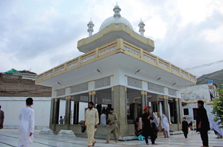Devotees visit the shrine of Saidu Baba. — Dawn