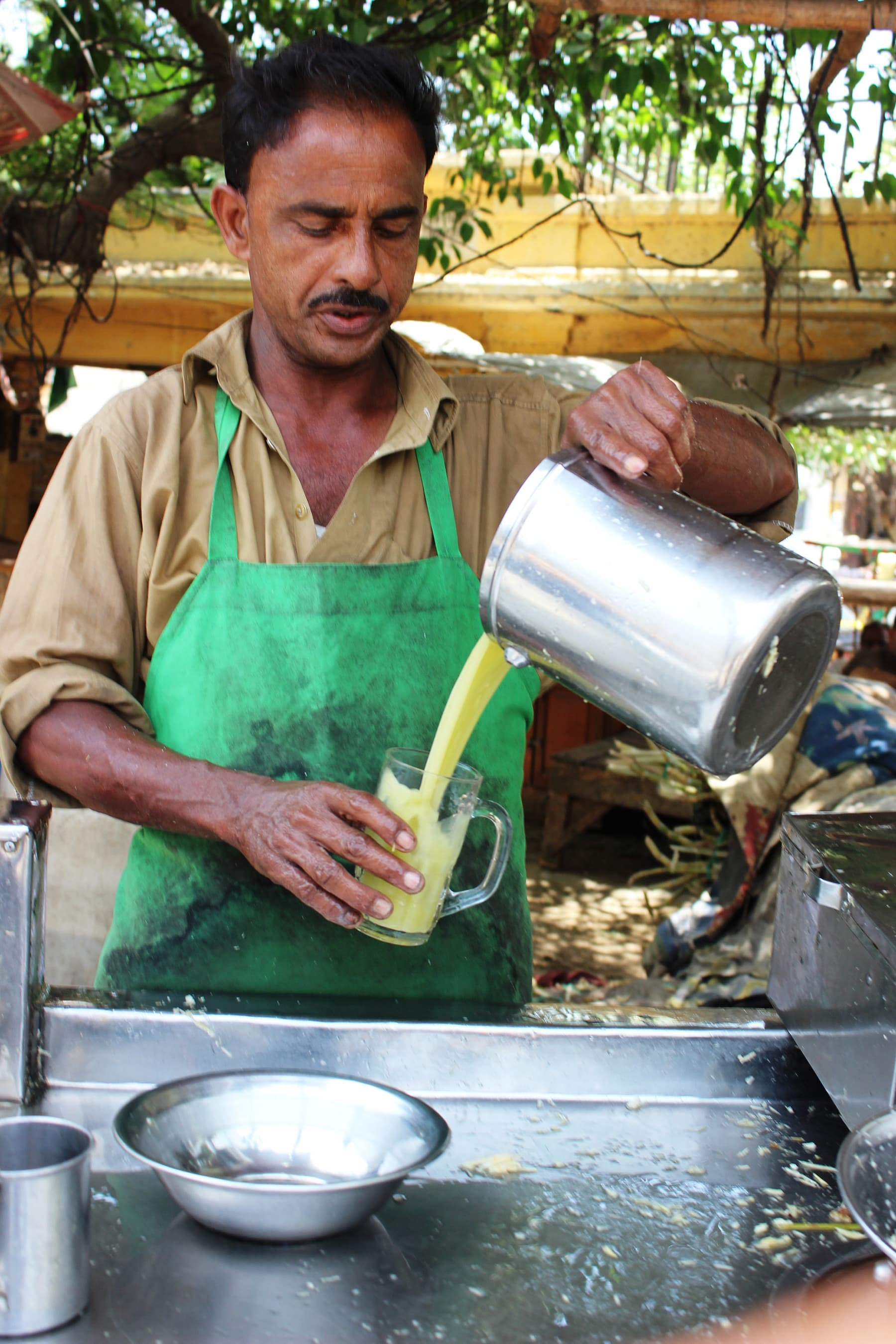 Sugarcane juice being poured out.