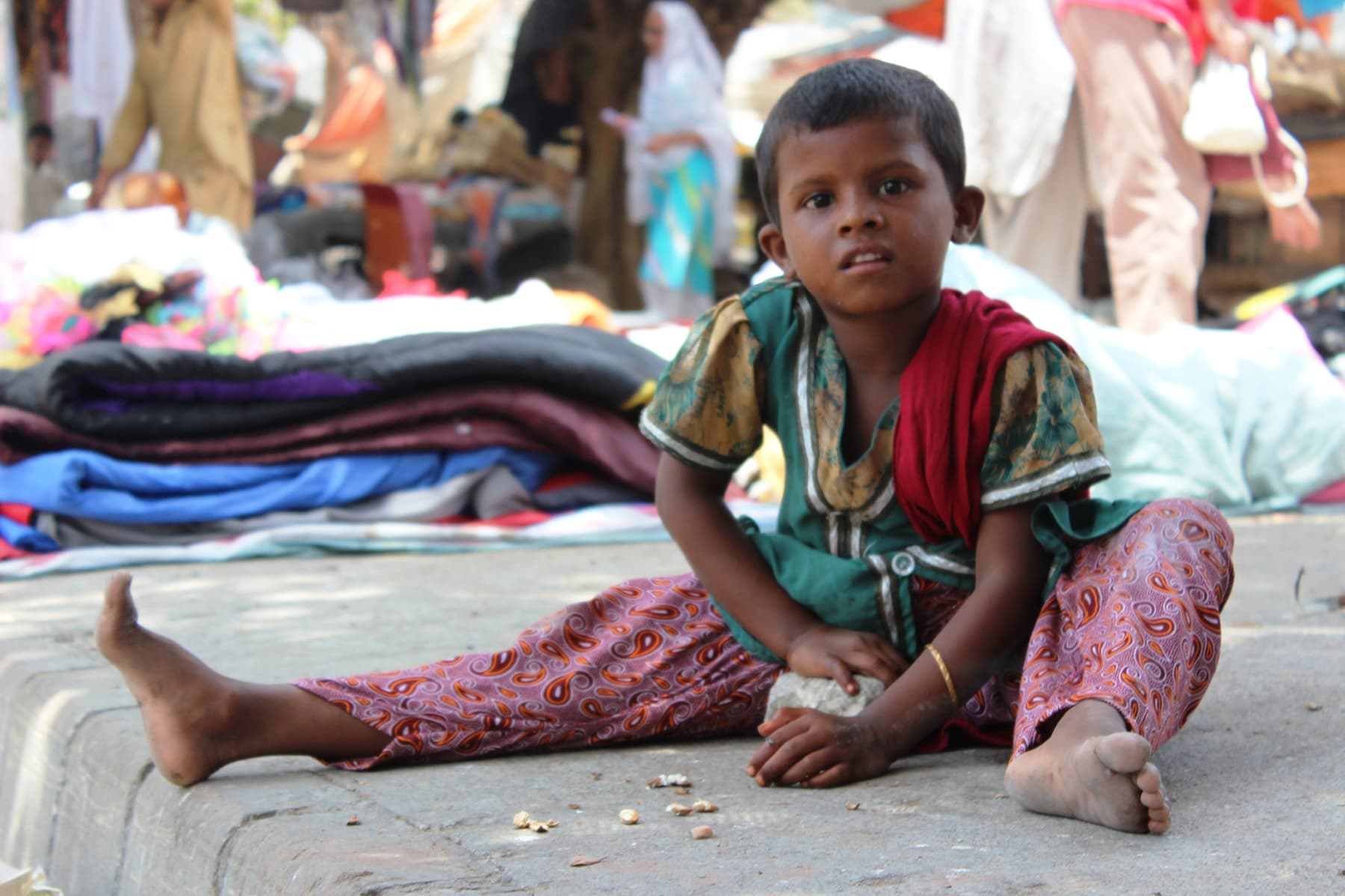 Slum girl Pooja on the streets of the bazaar.