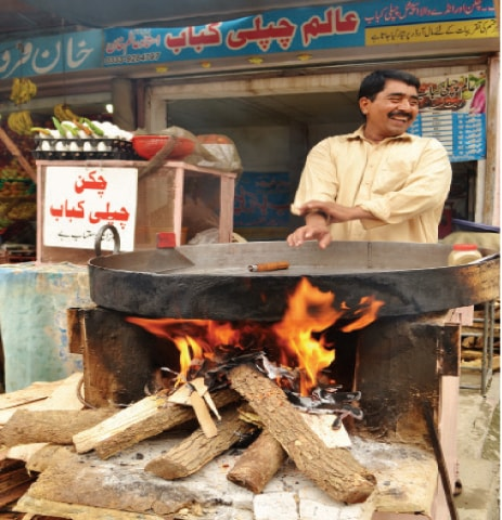 Chef Alam Khan prepares the vat at his shop in Peshawar Mor. — Photos by the writer