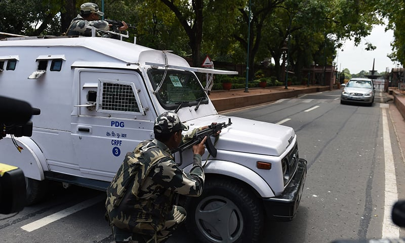 Security personnel take positions after an alert at the parliament in New Delhi. —AFP