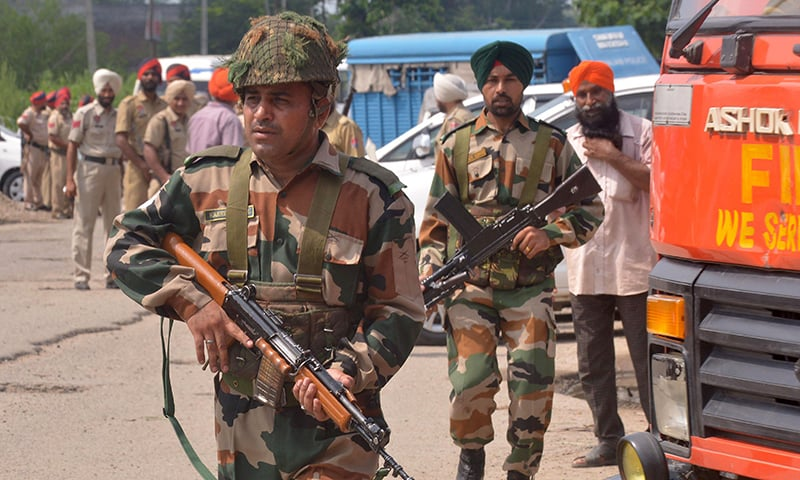 Indian Army personnel take position during an encounter with armed attackers at the police station in Gurdaspur district of Punjab state. -AFP