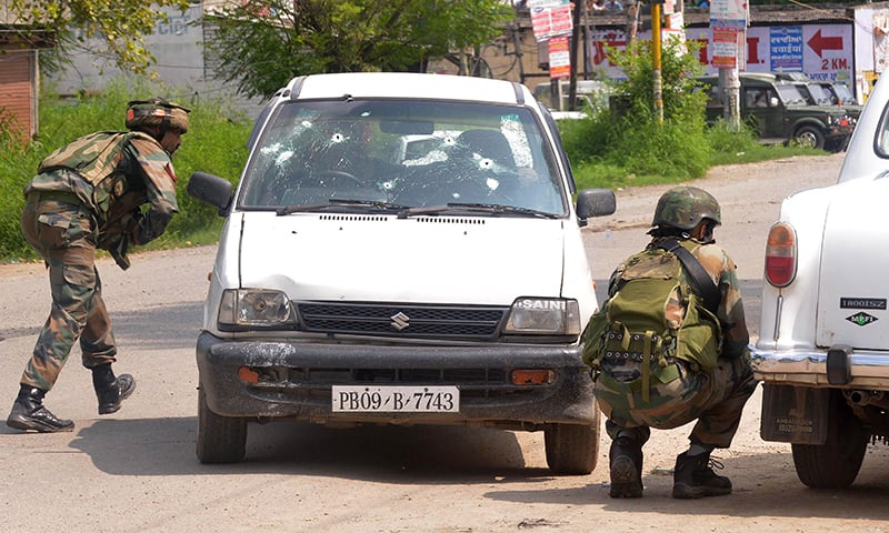 Indian Army soldiers take position during an encounter with armed attackers at the police station in Gurdaspur district of Punjab state. -AFP