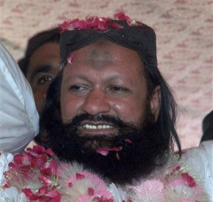 In this photo taken on July 15, 2011, Malik Ishaq is greeted by supporters with rose-petals upon his arrival in hometown after his release from jail, in Rahim Yar Khan. – AP/File