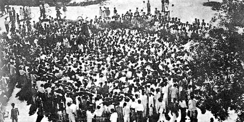 Dhaka, East Pakistan: A large number of people gather (to protest) at the site of a road sign that was changed from Bengali to Urdu.