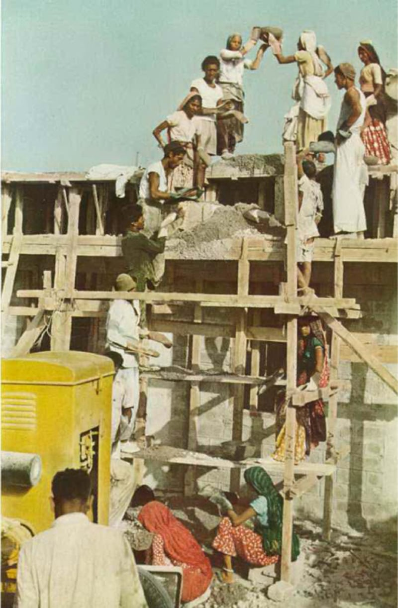 Men and women labourers working on the construction of a building in Karachi, 1951.