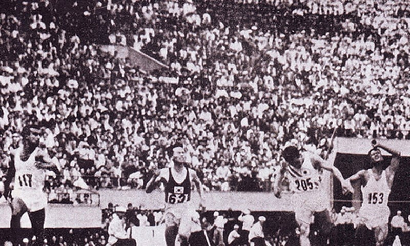 Pakistani sprinter, Abdul Khalique (left), on his way to winning Pakistan's first international gold medal in athletics. He won this honour in the 1959 Commonwealth Games in the 100 meters dash.