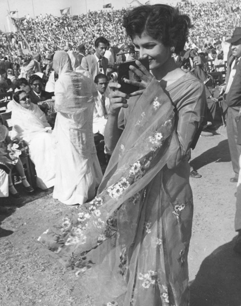 A participant films a festival in Karachi (1958).