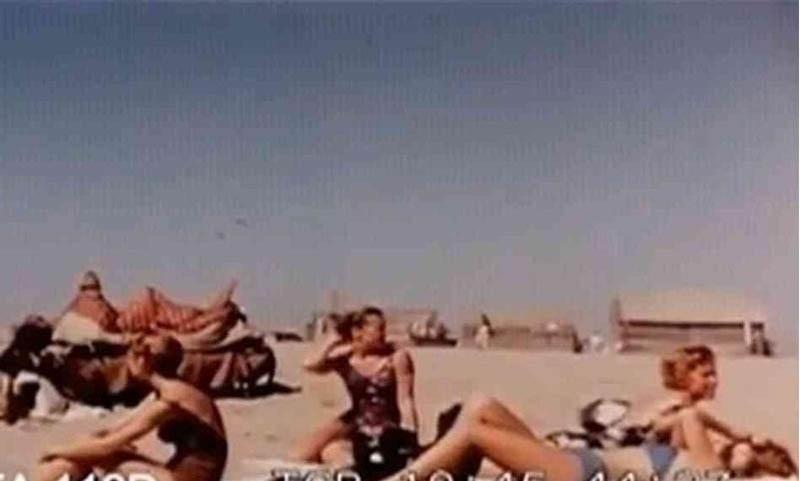 Tourists sunbathe at a Karachi beach in 1962.