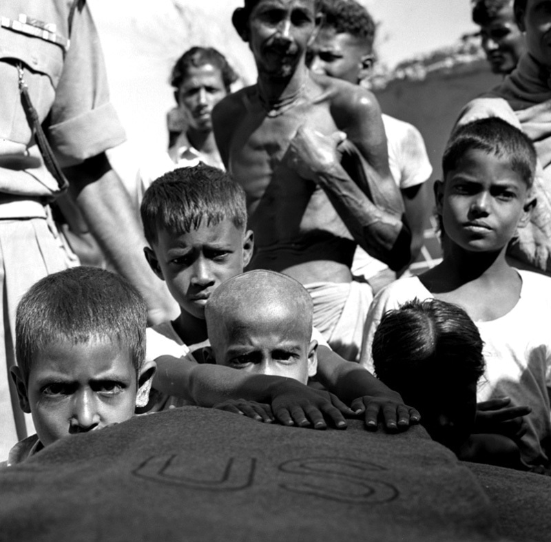 Children line up to receive food and medicines donated by the US in Chittagong (East Pakistan) in 1961.
