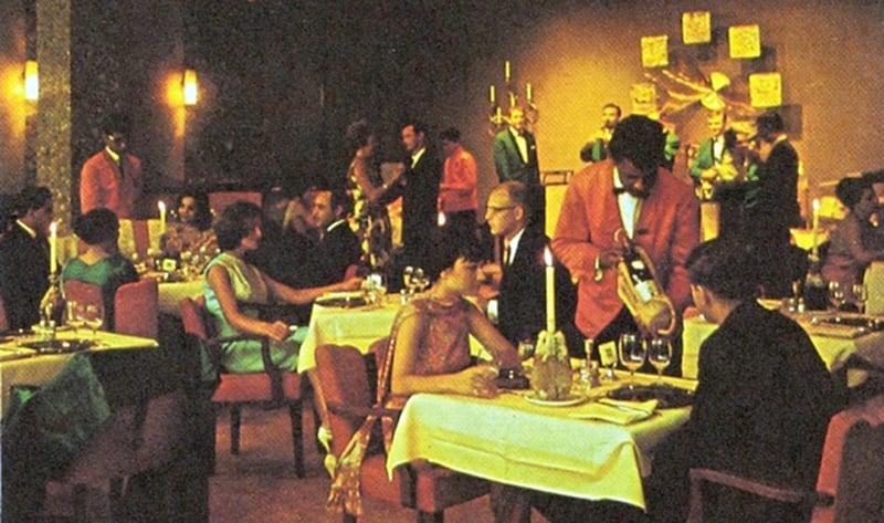 Tourists and locals enjoy dinner and drinks at Karachi's Beach Luxury Hotel during the 1969 News Year's eve.