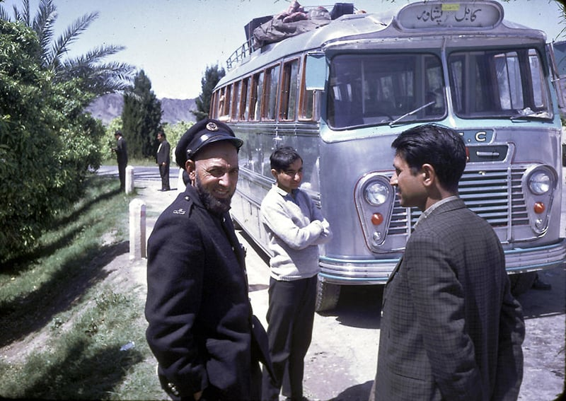 A conductor of a bus that ran from Peshawar to Kabul (and back) waits for passengers in Peshawar (1967).