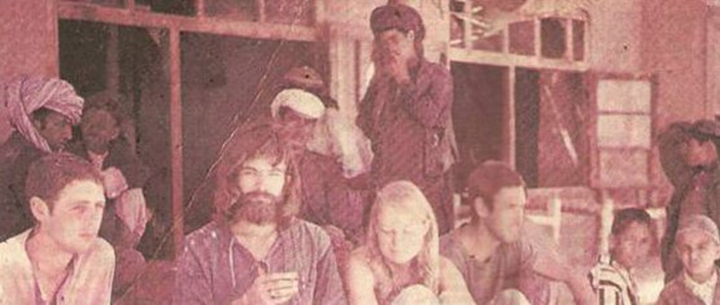 Hippie tourists mingle with the locals at an eatery in Ziarat, Balochistan (1974).