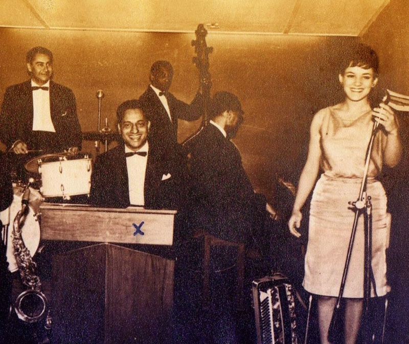 A Pakistani Jazz and club band shooting a scene for the 1974 Urdu film 'Dhamaka.' The film was scripted by famous Urdu spy novelist, Ibn-e-Safi.
