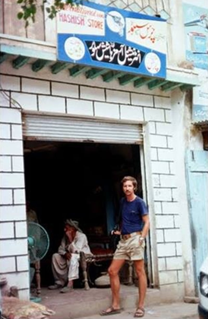 A German tourist outside a 'legal' hashish store in the North Waziristan area of Pakistan (1976).