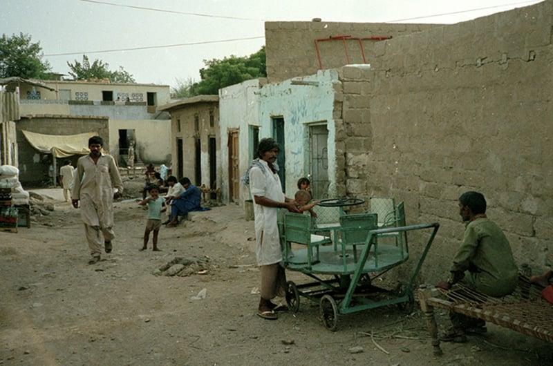 A street at a slum in Karachi, 1984.
