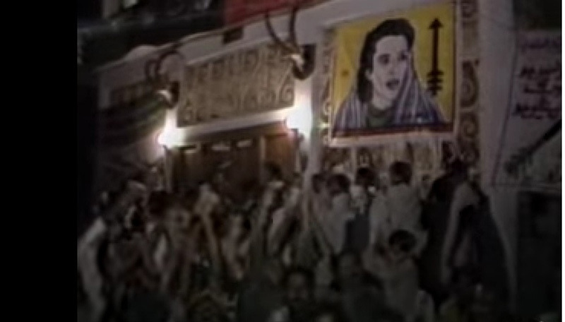Supporters of the PPP celebrate the party's victory in the 1988 election in Karachi's Lyari area. A poster of the then PPP chairperson, Benazir Bhutto, can also be seen. She became the first ever woman Prime Minister in the Muslim world.