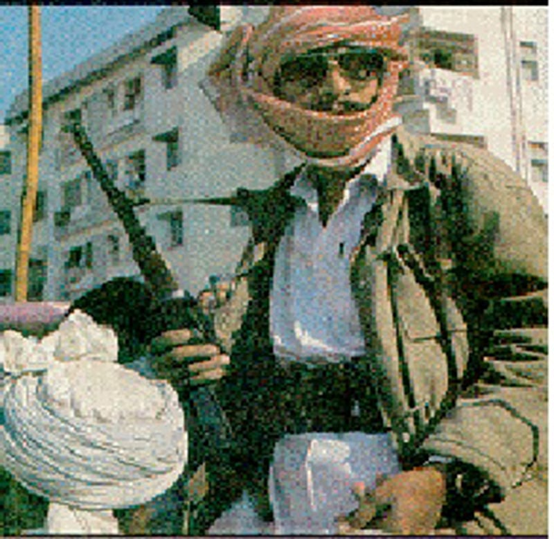 An armed man at a rally of a sectarian outfit in Lahore (1998).