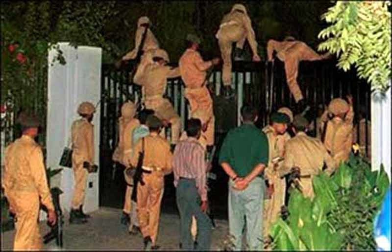 Soldiers climb the gates of the PTV headquarters in Islamabad during General Parvez Musharraf's 1999 military coup.
