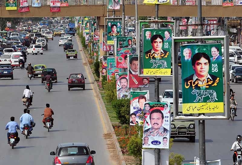 A road in Rawalpindi lined up with posters during the 2013 election. The elections were swept by Nawaz Sharif's PML-N.