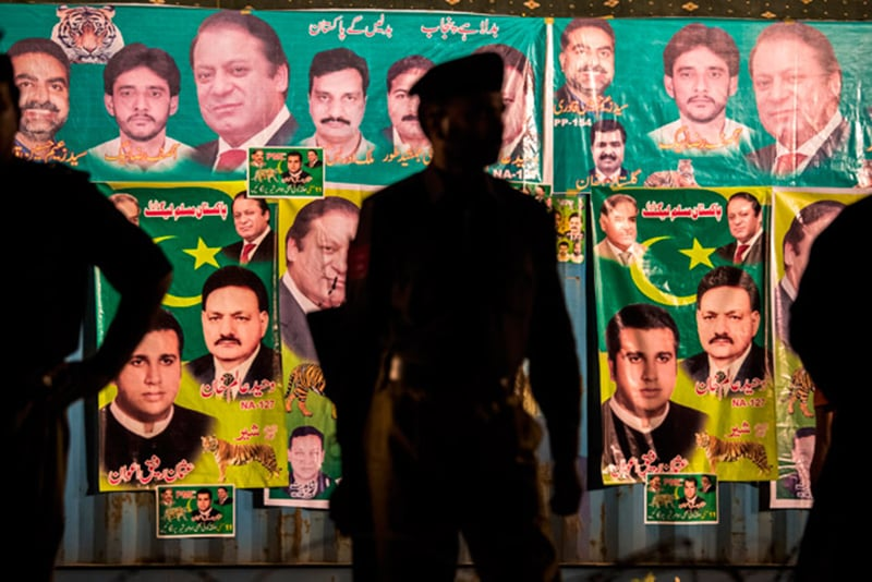 Police guard a polling station in Lahore during the 2008 elections.