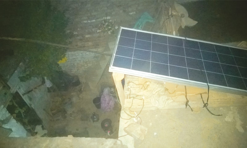 A solar panel on the roof of a house