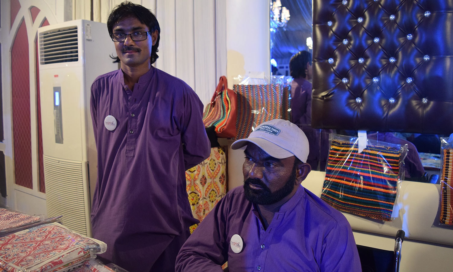 Sakhawat and Pervaiz with their stall 'Heartwork'. — Photo by Yumna Rafi