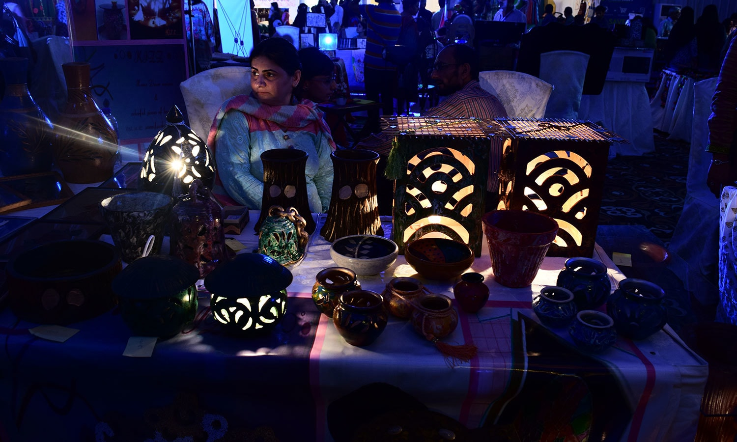 Carved lamps bring a glow in the dark light. — Photo by Zoya Anwer