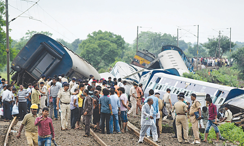 Harda (India): People look at the wreckage after the accident.—AP