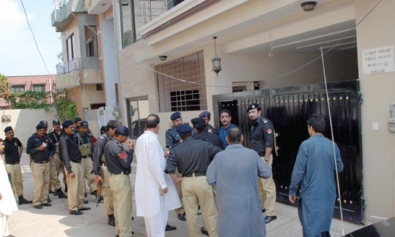 Police officials stand outside the house of Additional District and Sessions judge Tahir Khan Niazi on Wednesday. —INP