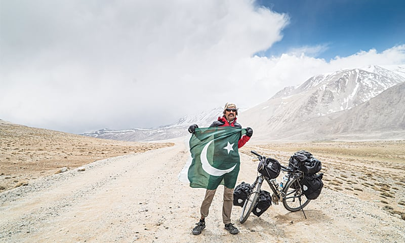 Wearing the Pakistani flag at an altitude of 4,344m while going through the Khargush Pass in Tajikistan