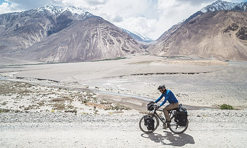 Cycling through the Wakhan Valley; across the Panj River is Afghanistan