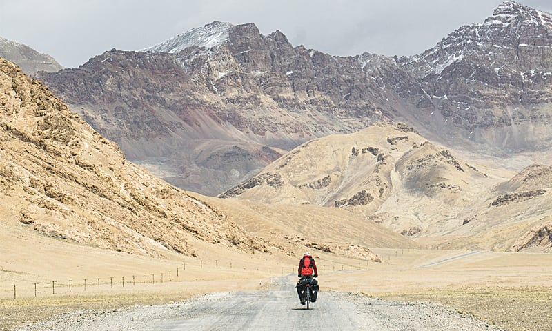 Cycling through the Pamir mountains on one of the many 4,000m passes in Tajikistan