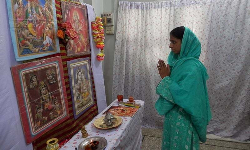 Geeta performing puja in the temple-room. —Akhtar Balouch