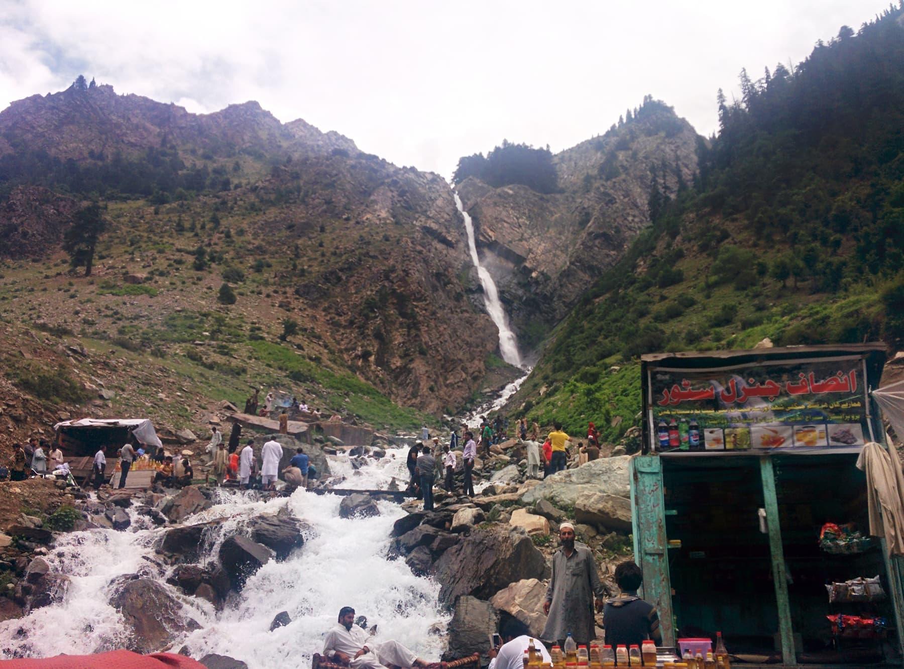 People having fun at a waterfall between Kalam and Mahodand.
