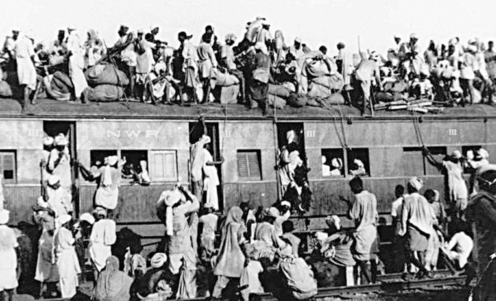 Muslim refugees sit atop an overcrowded train near New Delhi trying to flee India on Sept 19, 1947. —AP