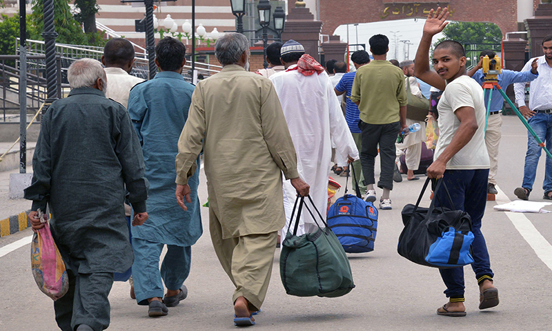 Released Pakistani prisoners prepare to cross the India-Pakistan border in Wagah. - AFP/File
