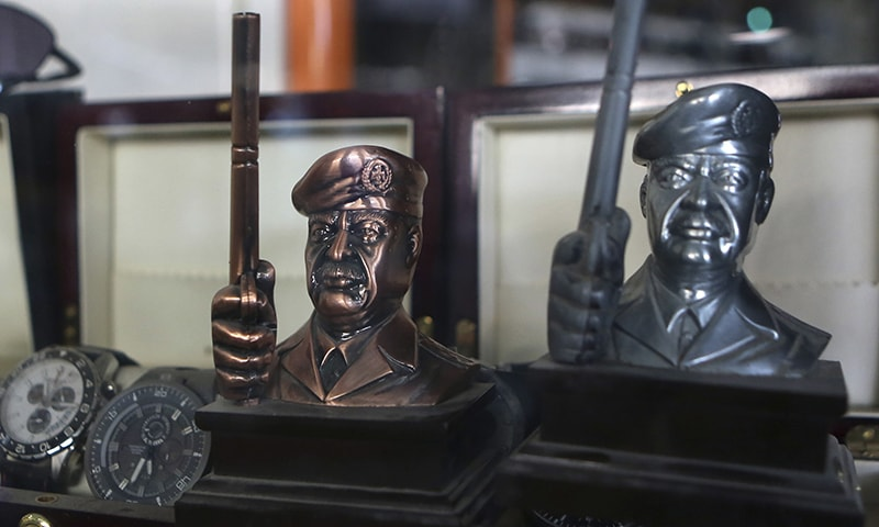 In this Aug. 4, 2015 photo, souvenirs of former Iraqi President Saddam Hussein are on display at a gift shop in Baghdad, Iraq. — AP