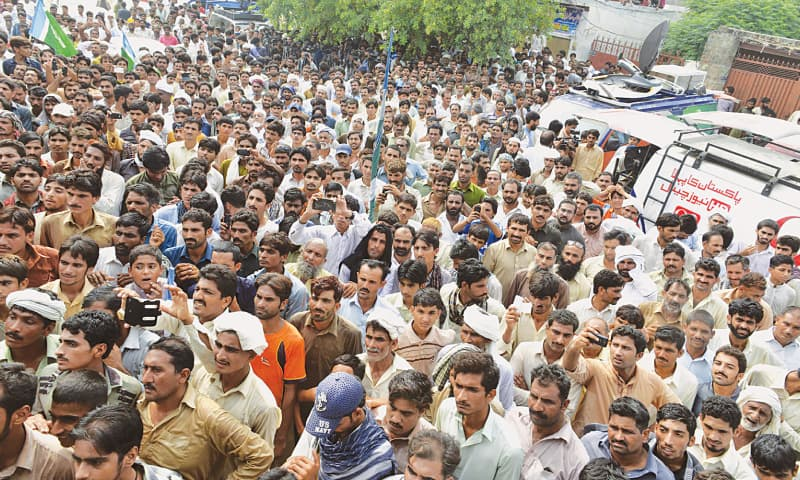 People gather on Sunday after Punjab Chief Minister Shahbaz Sharif announced a judicial probe into the child abuse scandal.—M. Arif/White Star