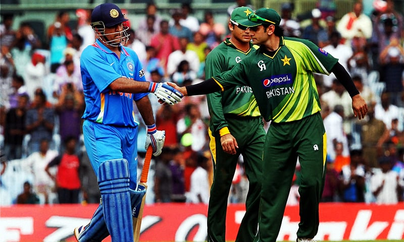 In this photo, Mahendra Singh Dhoni is being greeted by Mohammad Hafeez during a one-day match between Pakistan and India in Chennai. — Photo: Press Trust of India