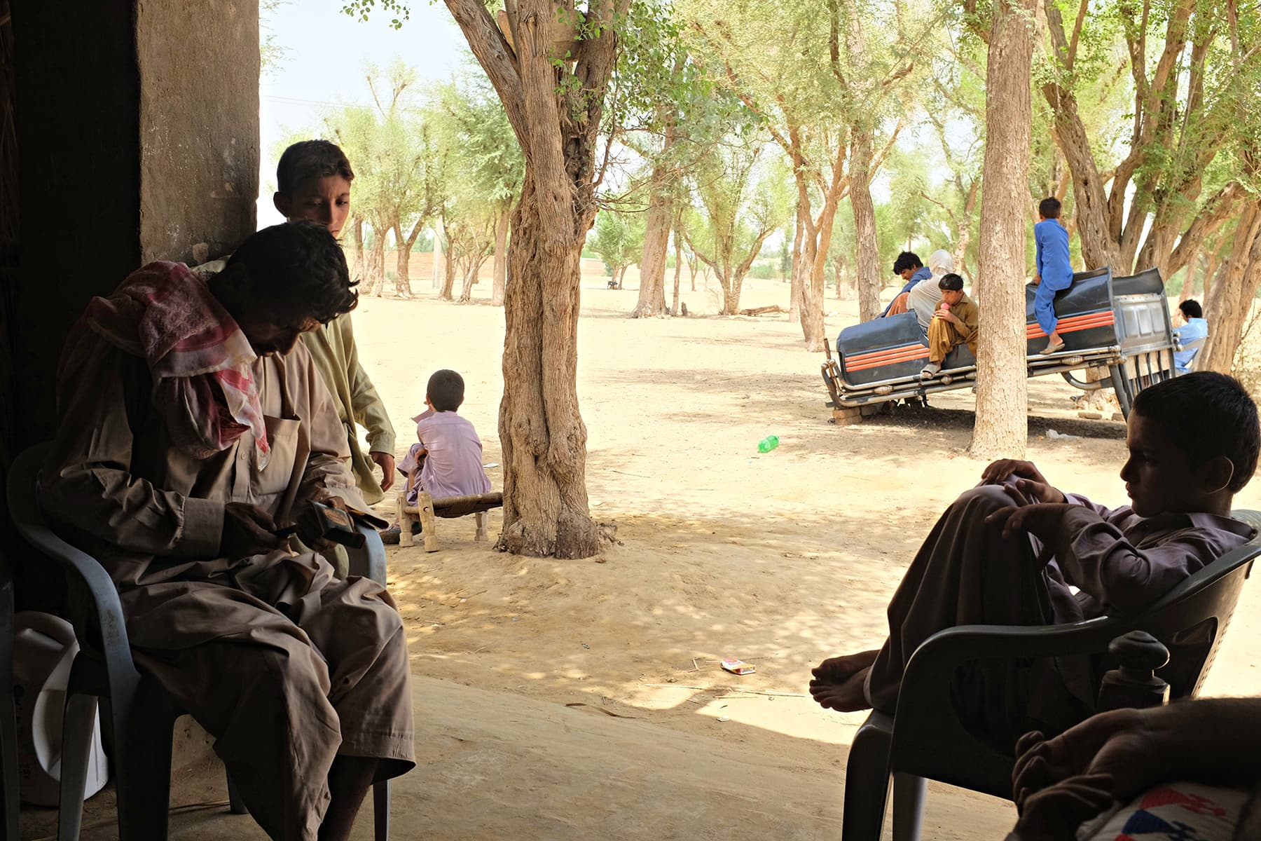 Children take a break in the shade.