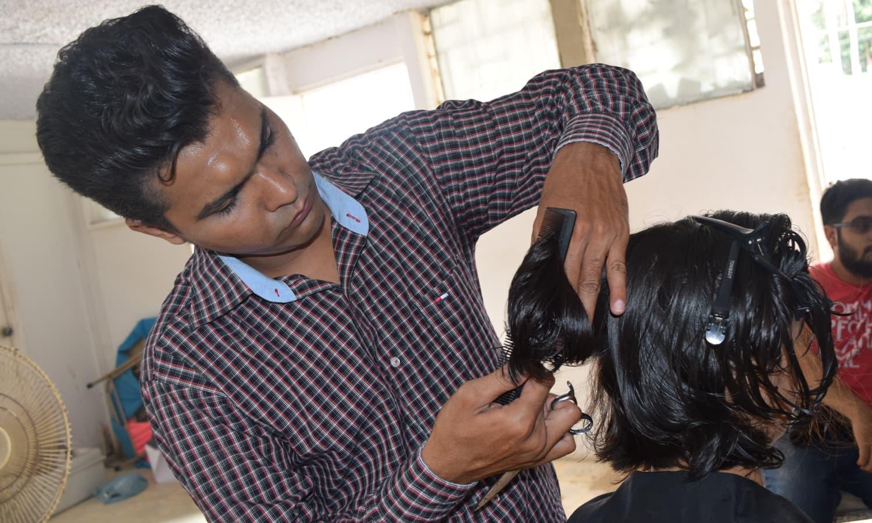 Shahid busy in the final cuts. — Photo by Yumna Rafi