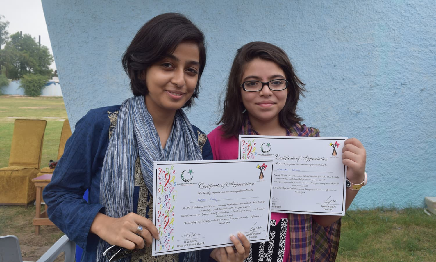 Maria and Rutaba pose with their certificates of participation. — Photo by Yumna Rafi